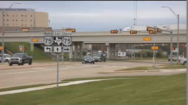 Hwy 75 overpass with signs on Hwy 691